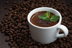 cup of hot mint chocolate on the background of coffee beans Stock Photos