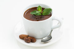 Cup with hot mint chocolate on white table, closeup Royalty Free Stock Image