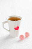 Cup of hot tea. And homemade pink truffles Royalty Free Stock Photos