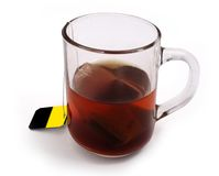A cup of hot tea. Isolated on a white background royalty free stock photos