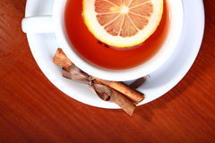 Cup of hot tea on brown background Royalty Free Stock Photos