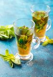 Cup of hot tea cane sugar dry tea leaves and mint herb royalty free stock photography