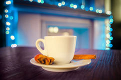 Cup of hot tea with cinnamon, nut and anise Royalty Free Stock Photo