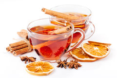 Cup of hot tea with cinnamon, orange, anise Stock Photography