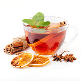 Cup of hot tea with cinnamon, orange, anise Royalty Free Stock Images