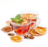 Cup of hot tea with cinnamon, orange, anise Royalty Free Stock Photos