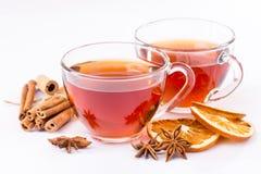 Cup of hot tea with cinnamon, orange, anise Stock Image
