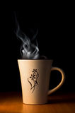 Cup of hot tea of coffee. Over black background Royalty Free Stock Images