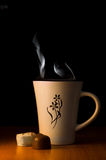 Cup of hot tea or coffee. With chocolate pralines Royalty Free Stock Photography