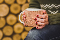 Cup of hot tea coffee cocoa in knitted Royalty Free Stock Images
