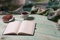 Cup with Hot Tea or Coffee. Warm Plaid, Book on a Wooden Table. with copy space Royalty Free Stock Image