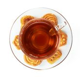 Cup of hot tea with cookies Royalty Free Stock Photos