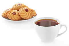 Cup of hot tea and cookies Stock Photos