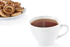 Cup of hot tea and cookies Royalty Free Stock Images