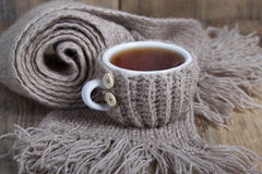A cup of hot tea in cover - warmer Stock Photo