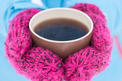Cup of hot tea in female hands at winter outdoor Royalty Free Stock Photography