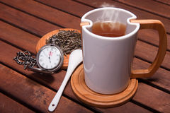 Tea time. A cup with hot tea, at five o' clock Stock Photo