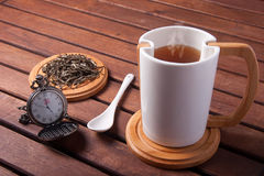 Tea time. A cup with hot tea, at five o' clock Stock Photography