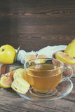 Cup of hot  tea and fresh quince fruit on table Royalty Free Stock Photo