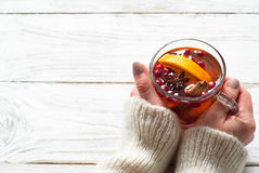 Cup of hot tea with fruit and spices. Stock Photo