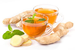 Cup of hot tea with ginger, lemon and mint Royalty Free Stock Image