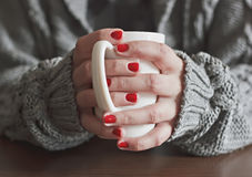 Cup of hot tea. In hands Stock Images