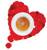 A cup of hot tea in the heart of rose petals Stock Photos