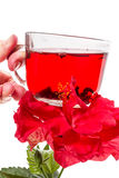 Cup of hot tea and hibiscus flower Stock Photos