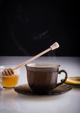 Cup of hot tea with honey and lemon slices. Hot tea with honey and lemon slices royalty free stock photography