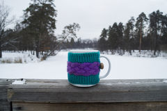 Cup of hot tea in a knit cover Royalty Free Stock Image
