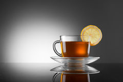 Cup of hot tea with lemon Stock Images