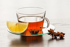 Cup of hot tea with lemon. Stock Photos