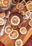 Cup of hot tea with lemon Stock Image