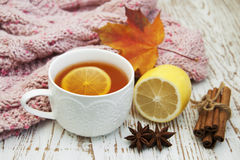 Cup of hot tea with lemon and scarf Royalty Free Stock Photos