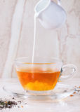 Cup of hot tea with milk Royalty Free Stock Image