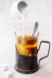 Cup of hot tea with milk Royalty Free Stock Images