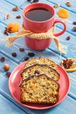 Cup of tea and fresh baked homemade fruitcake on plate Stock Image