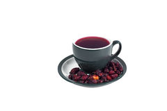 A cup of hot tea from rose hips vitamin warm winter and cure colds. Stock Images