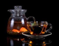Cup of hot tea with a saucer and jug Royalty Free Stock Photo