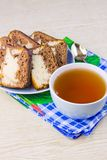 Cup with hot tea and sweet cakes Stock Image