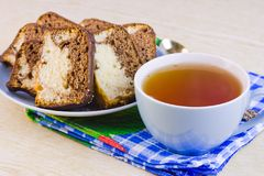 Cup with hot tea and sweet cakes Stock Photos