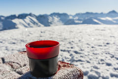 Cup of hot tea on a table with a boundary marker. Stock Photography