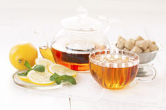 Cup of hot tea tea, sugar and lemon on a light background Royalty Free Stock Photo