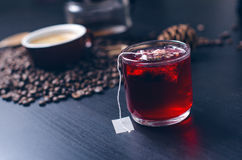 Cup of hot tea with teabag. On a natural, dark background. Cup is from clear glass Royalty Free Stock Photos
