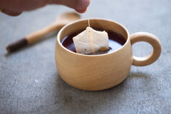 Cup of hot tea with teabag Stock Images