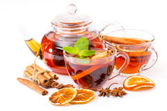 Cup of hot tea and teapot. cinnamon, orange, anise Royalty Free Stock Photos