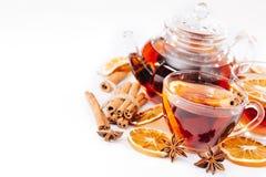 Cup of hot tea and teapot. cinnamon, orange, anise Stock Image