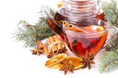 Cup of hot tea and teapot. cinnamon, orange, anise Stock Images