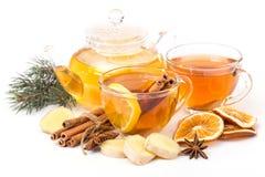 Cup of hot tea and teapot. cinnamon, orange, anise Stock Photos