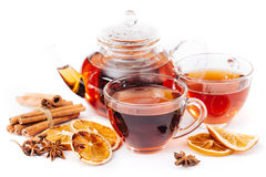 Cup of hot tea and teapot. cinnamon, orange, anise Royalty Free Stock Images